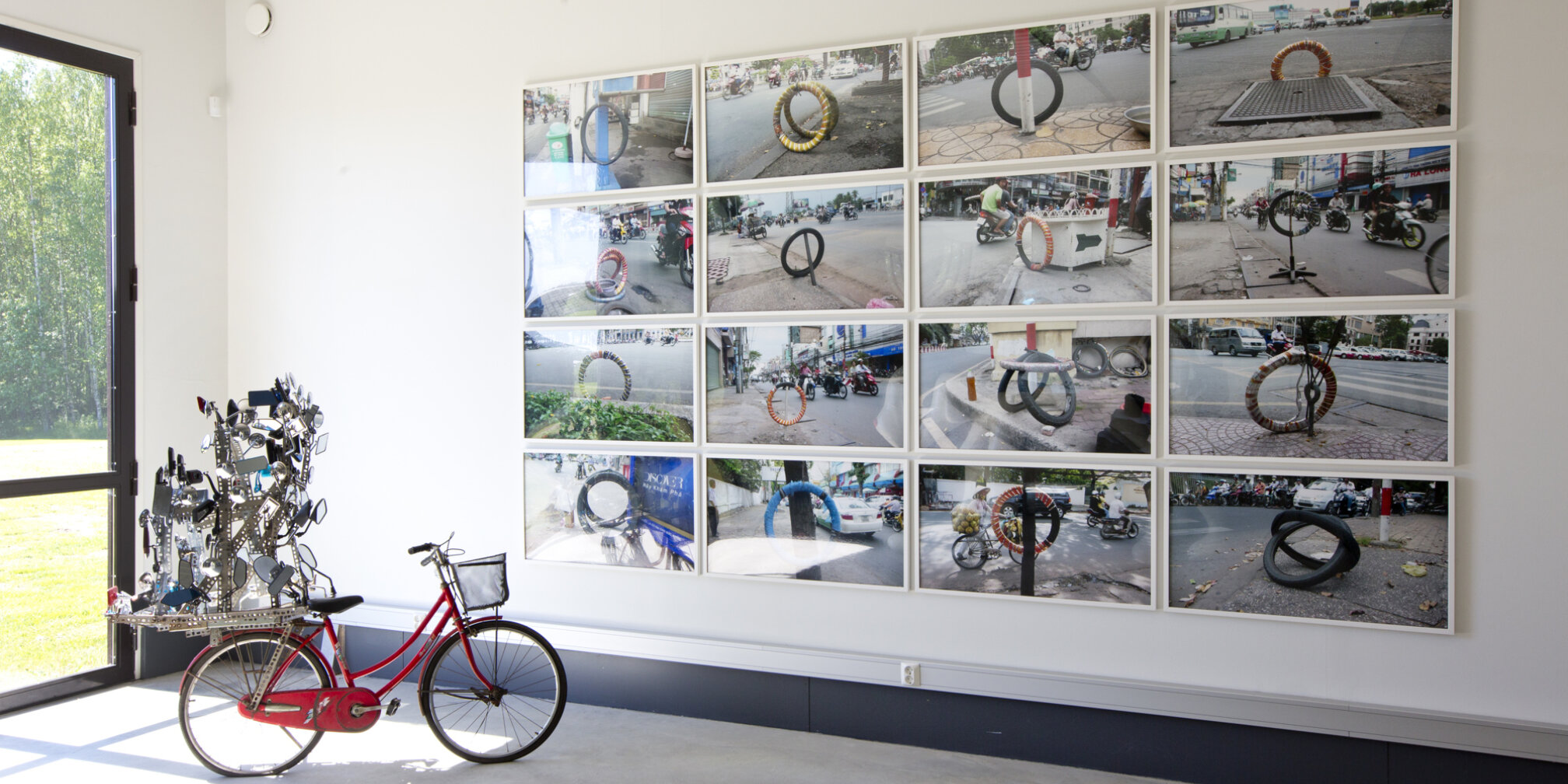 Dinh Q Lê, I am Large. I Contain Multitudes, 2009 and Bicycle Repair Signals, 2009. Installation view. Photo: David Bebber