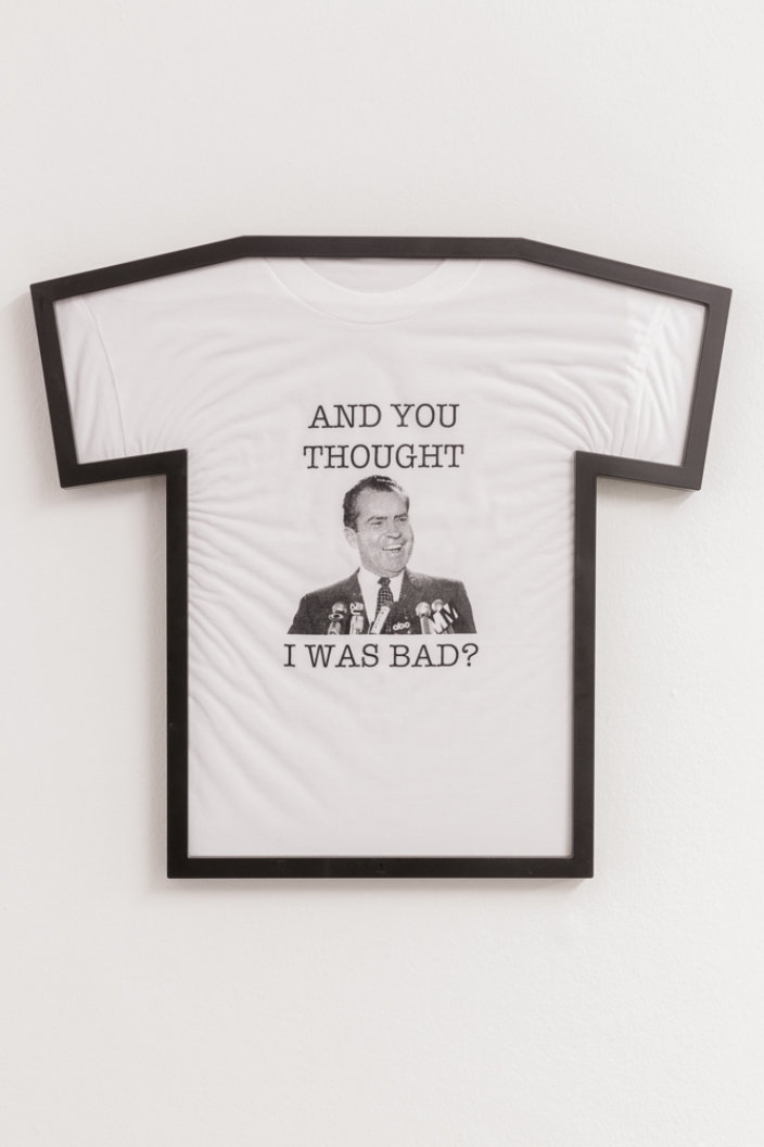 Guy Oliver, And You Thought I Was Bad? (Nixon T-shirt), 2018. Silkscreen on fabric T-shirt, frame. Courtesy the artist and Zabludowicz Collection. Photo Tim Bowditch.